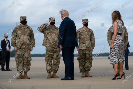 President Donald Trump and first lady Melania Trump arrive at Pope Army Field for an event with troops at Fort Bragg, in Pope Field, N.C