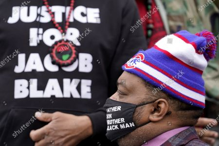 Stock Picture of Jacob Blake Jr. listens to a speech during a Get Out The Vote rally in Chicago, . The families of Breonna Taylor, George Floyd, Alvin Cole and Jacob Blake encouraged residents to vote