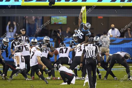 Carolina Panthers defensive tackle Derrick Brown (95) attempts to block a field goal attempt by Atlanta Falcons place kicker Younghoe Koo (7) during an NFL football game, in Charlotte, N.C