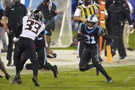 Carolina Panthers safety Jeremy Chinn (21) runs for a first down on a fake punt against the Atlanta Falcons during an NFL football game, in Charlotte, N.C
