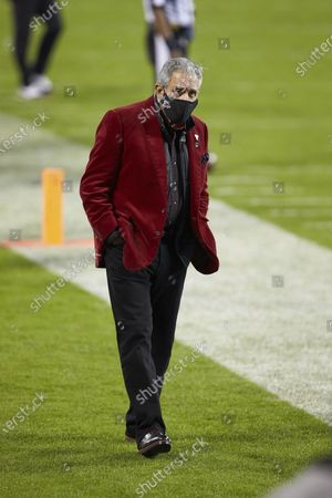 Atlanta Falcons owner Arthur Blank walks the sideline during an NFL football game against the Carolina Panthers, in Charlotte, N.C