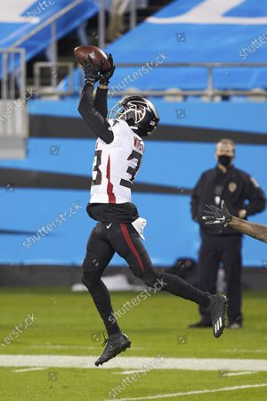Atlanta Falcons safety Blidi Wreh-Wilson (33) intercepts a pass to seal the win over the Carolina Panthers during an NFL football game, in Charlotte, N.C