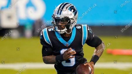 Carolina Panthers quarterback P.J. Walker warms up before an NFL football game against the Atlanta Falcons, in Charlotte, N.C