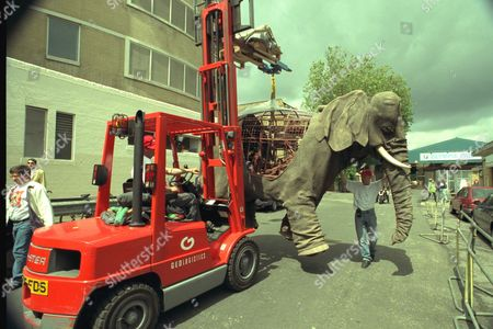 The Jumbo Fine Art............... All Pictures Show The Delicate Operation To Get A Full Sized Mechanical Elephant Into The Olympia Hall In West London In Time For The Fine Art And Antiques Fair Opening Today June 4. Pictures Shows The Scene As The Elephant Worth 100;00 Is Moved Into The Hall. Sitting On Top Of The Elephant Is Emma Hawkins Andcc David Dickinson And Hugh Kennedy. Other Pictures Show Emma Hawkins Alone On The Elephant As It Walks With Ears Flapping. Contact Is Emma Hawkins On 0131/229/2828 And Mobile 0831/093198 Caption Ends..........