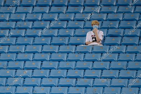 Atlanta Falcons fan watches during warm ups before an NFL football game between the Carolina Panthers and the Atlanta Falcons, in Charlotte, N.C