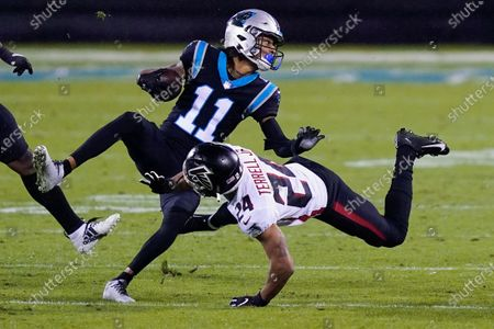 Carolina Panthers wide receiver Robby Anderson is tackled by Atlanta Falcons cornerback A.J. Terrell during the second of an NFL football game, in Charlotte, N.C