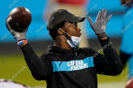 Carolina Panthers quarterback Teddy Bridgewater warms up before an NFL football game against the Atlanta Falcons, in Charlotte, N.C