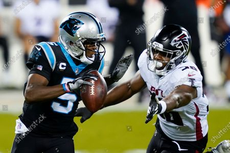 Carolina Panthers quarterback Teddy Bridgewater looks to pass under pressure from Atlanta Falcons defensive end Dante Fowler Jr. during the first half of an NFL football game, in Charlotte, N.C