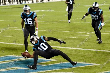 Carolina Panthers wide receiver Curtis Samuel scores against the Atlanta Falcons during the first half of an NFL football game, in Charlotte, N.C