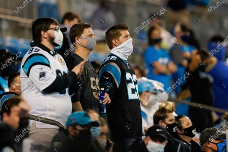 Fans watch during the first half of an NFL football game between the Carolina Panthers and the Atlanta Falcons, in Charlotte, N.C