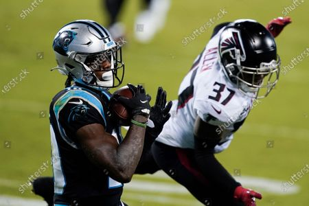 Carolina Panthers wide receiver Curtis Samuel scores past Atlanta Falcons free safety Ricardo Allen during the first half of an NFL football game, in Charlotte, N.C