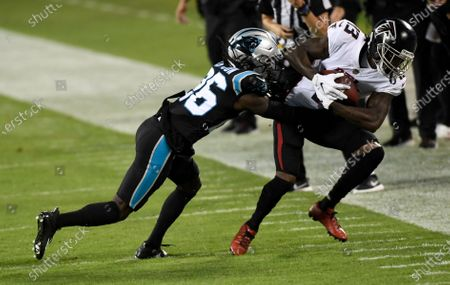 Atlanta Falcons wide receiver Christian Blakeis tackled by Carolina Panthers cornerback Donte Jackson during the first half of an NFL football game, in Charlotte, N.C