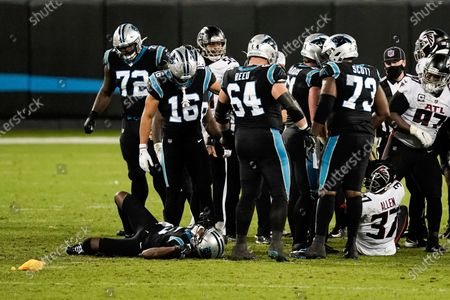 Carolina Panthers quarterback Teddy Bridgewater is injured on the field during the second of an NFL football game against the Atlanta Falcons, in Charlotte, N.C