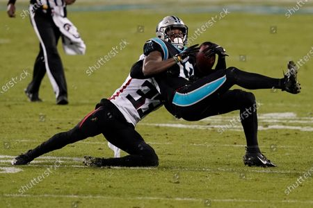 Carolina Panthers wide receiver Curtis Samuel is tackled by Atlanta Falcons cornerback Blidi Wreh-Wilson during the second of an NFL football game, in Charlotte, N.C