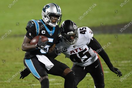 Carolina Panthers quarterback Teddy Bridgewater runs around Atlanta Falcons linebacker Deion Jones during the second half of an NFL football game, in Charlotte, N.C