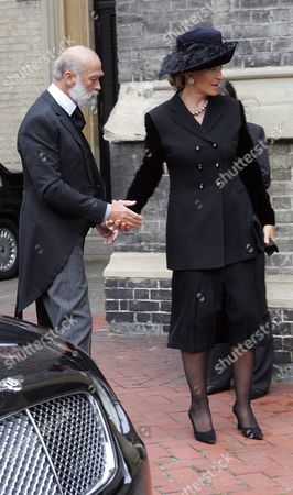 Stock Picture of Prince Michael And Princess Michael At Funeral Of Mark Birley Founder Of Annabels Nightclub - More Than 500 Mourners Attended Today's Funeral For Mark Birley At The St Paul's Church In Knightsbridge Including Lady Thatcher Prince And Princess Michael Of Kent The Sarah Duchess Of York. Other Congregants Included Alan Whicker Rupert Hambro Ed Victor Sir David Frost Jonathan Aitken Lord Weidenfeld And Richard Caring Who Bought Up Birley's Annabel's Nightclub Empire For A120 Million. Also In Attendance Were Birley's Dogs His Alsatian Tara And His Black Labrador George Who Both Obediently Sat Near The Front Pew During The Service. Although Mark Birley Virtually Disinherited His Son Robin From His Will Over A Family Dispute The Family Was Determined Today To Try And Put On A United Front. Robin Did Turn Up But He Played No Formal Part In The Service Other Than Accompanying His Mother Lady Annabel Goldsmith To The Church. There Were Two Readings One By Birley's Daughter India Jane Birley And The Other By His First Wife Lady Annabel Goldsmith. A Male Soloist Sang 'a Nightingale Sang In Berkeley Square' And There Was An Orchestral Rendering Of The Londonderry Air A Traditional Irish Melody. The Address Was Given By Peter Blond An Eton Contemporary Who First Met Mark Birley In 1944. He Recalled How Birley's Teacher At Eton Said He Was 'able But Idle'. 'he Had An Amazing Eye For Detail ' Continued Blond. 'he Transformed London. Goodbye Old Friend. Thank You For Those Amazing Times.'