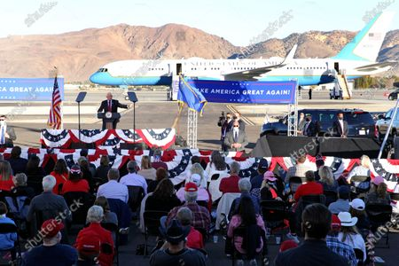 Vice President Mike Pence, back left, gestures as he speaks at a campaign rally at Reno-Tahoe International Airport in Reno, Nev