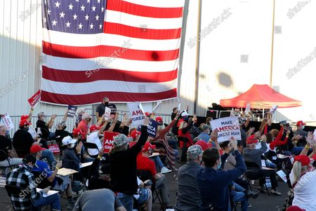 Stock Image of Supporters respond to a speech by Vice President Mike Pence at a campaign rally at Reno-Tahoe International Airport in Reno, Nev