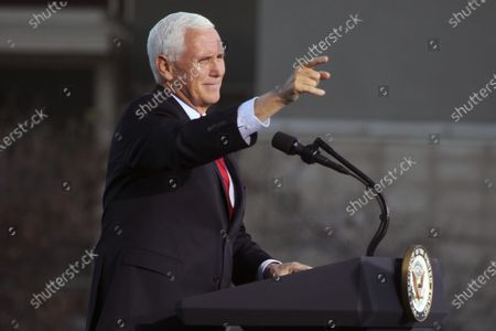 Vice President Mike Pence gestures as he speaks at a campaign rally at Reno-Tahoe International Airport in Reno, Nev
