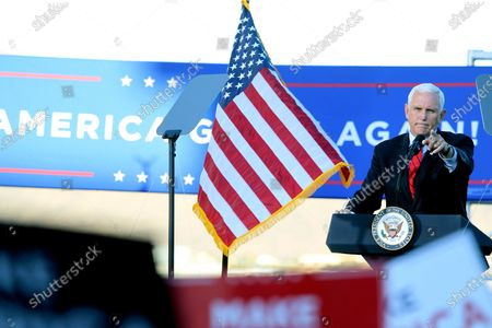 Stock Photo of Vice President Mike Pence gestures at a campaign rally at the Reno-Tahoe International Airport in Reno, Nev