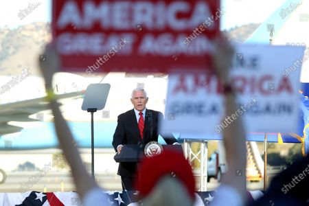 Vice President Mike Pence speaks at a campaign rally at the Reno-Tahoe International Airport in Reno, Nev