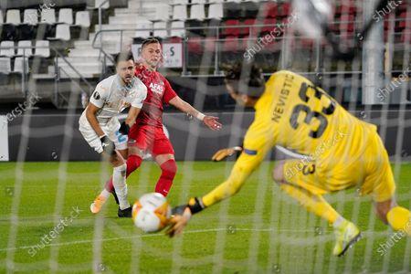 Albert Gudmundsson scores 3-0 on goalkeeper Ivan Nevistic of Rijeka