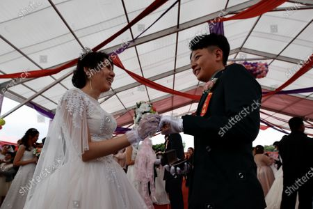 Couple Ying-Hsuan Chen (R) and Li-Chen Li(L) react during a military mass wedding in Taoyuan, Taiwan, 30 October 2020. Two same sex couples tied the knot as part of a mass wedding held by the Taiwan military. According to news reports, it is the first time that same sex couples got married as part of a mass wedding held by the military since Taiwan became the first country in Asia to legalize same-sex marriage in May 2019.
