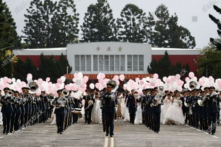 A general view or the military couples including the LGBT couples Ying-Hsuan Chen, Li-Chen Li and Yi Wang, Yumi Meng during a military mass wedding in Taoyuan, Taiwan, 30 October 2020. Two same sex couples tied the knot as part of a mass wedding held by the Taiwan military. According to news reports, it is the first time that same sex couples got married as part of a mass wedding held by the military since Taiwan became the first country in Asia to legalize same-sex marriage in May 2019.