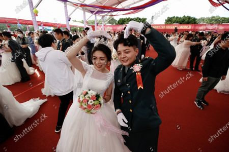 Couple Ying-Hsuan Chen (R) and Li-Chen Li(L) pose for a photograph during a military mass wedding in Taoyuan, Taiwan, 30 October 2020. Two same sex couples tied the knot as part of a mass wedding held by the Taiwan military. According to news reports, it is the first time that same sex couples got married as part of a mass wedding held by the military since Taiwan became the first country in Asia to legalize same-sex marriage in May 2019.