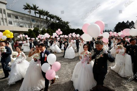 Stock Image of A general view of military couples, including LGBT couples Ying-Hsuan Chen, Li-Chen Li and  Yi Wang, Yumi Meng during a military mass wedding in Taoyuan, Taiwan, 30 October 2020. Two same sex couples tied the knot as part of a mass wedding held by the Taiwan military. According to news reports, it is the first time that same sex couples got married as part of a mass wedding held by the military since Taiwan became the first country in Asia to legalize same-sex marriage in May 2019.