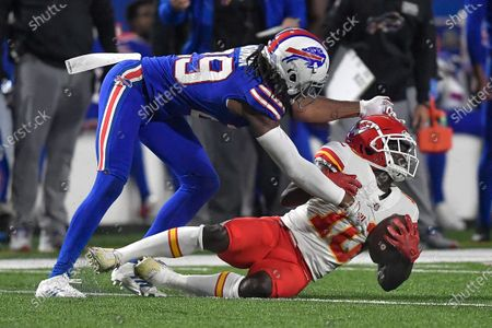 Kansas City Chiefs wide receiver Tyreek Hill, right, is tackled by Buffalo Bills cornerback Josh Norman during the second half of an NFL football game, in Orchard Park, N.Y