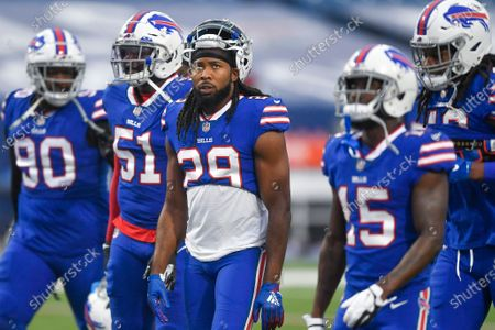 Stock Photo of Buffalo Bills cornerback Josh Norman (29) heads to the locker room with teammates before an NFL football game against the Kansas City Chiefs, in Orchard Park, N.Y