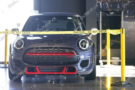 Hold For Biz-New Car Sales-Caution tape surrounds a 2020 John Cooper Works GP hardtop at a Mini dealership, in Highlands Ranch, Colo