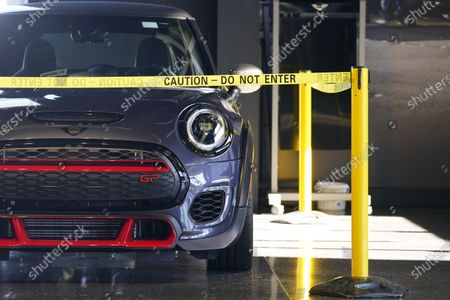 Hold For Biz-New Car Sales-Caution tape surrounds a rare 2020 John Cooper Works GP hardtop on the showroom floor at a Mini dealership, in Highlands Ranch, Colo