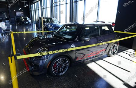 Hold For Biz-New Car Sales-Caution tape surrounds a rare, 2020 John Cooper Works GP on display on the showroom floor at a Mini dealership, in Highlands Ranch, Colo