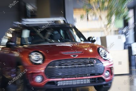 Hold For Biz-New Car Sales-With a twist of a zoom lens and a slow shutter speed, a 2020 Clubman S looks animated while on display at a Mini dealership, in Highlands Ranch, Colo