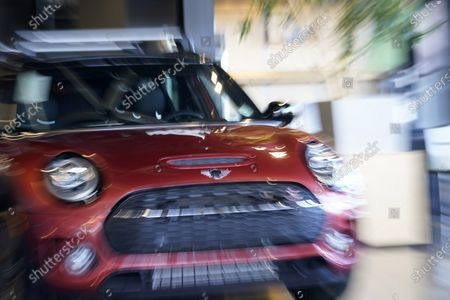 Hold For Biz-New Car Sales-With a twist of the ring on a zoom lens at a slow shutter speed, a 2020 Clubman S look animated while on display at a Mini dealership, in Highlands Ranch, Colo