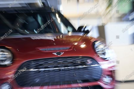 Hold For Biz-New Car Sales-With a twist of the zoom ring on a lens at a slow shutter speed, a 2020 Clubman S looks animated while on display at a Mini dealership, in Highlands Ranch, Colo
