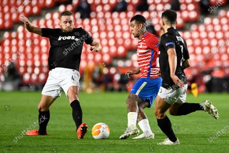 Granada CF player Robert Kenedy and PAOK FC player Sverrir Ingi Ingason are seen in action during the Europa League match between Granada CF and PAOK FC at Nuevo los Carmenes Stadium in Granada. (Final score; Granada CF 0:0 PAOK)