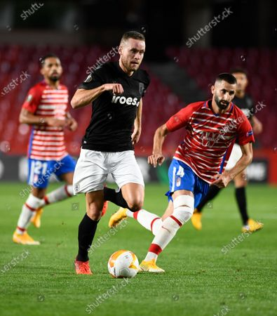 PAOK FC player Sverrir Ingi Ingason and Granada cF player Maxim Gonalons are seen in action during the Europa League match between Granada CF and PAOK FC at Nuevo los Carmenes Stadium in Granada. (Final score; Granada CF 0:0 PAOK)