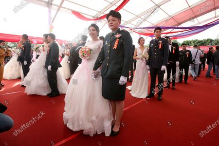 Lesbian couple Chen Ying-hsuan, right, and Li Li-chen attend a military mass weddings ceremony in Taoyuan city, northern Taiwan, . Two lesbian couples tied the knot in a mass ceremony held by Taiwan's military on Friday in a historic step for the island. Taiwan is the only place in Asia to have legalized gay marriage, passing legislation in this regard in May 2019