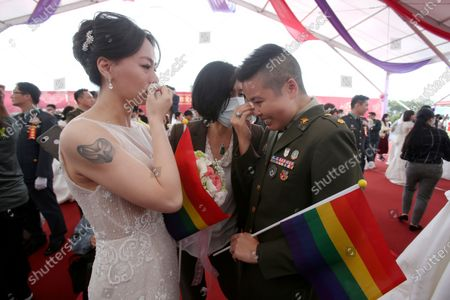 Lesbian couple Yi Wang, right, and Yumi Meng reacts for joy during a military mass weddings ceremony in Taoyuan city, northern Taiwan, . Two lesbian couples tied the knot in a mass ceremony held by Taiwan's military on Friday in a historic step for the island. Taiwan is the only place in Asia to have legalized gay marriage, passing legislation in this regard in May 2019