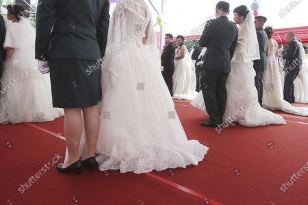 Image libre de droits de Lesbian couple Chen Ying-hsuan, from left, and Li Li-chen attend a military mass weddings ceremony in Taoyuan city, northern Taiwan, . Two lesbian couples tied the knot in a mass ceremony held by Taiwan's military on Friday in a historic step for the island. Taiwan is the only place in Asia to have legalized gay marriage, passing legislation in this regard in May 2019