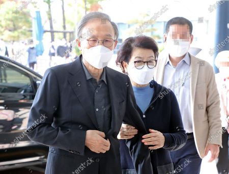 Former President Lee Myung-bak (L), helped by his wife, Kim Yoon-ok (R), arrives at Seoul National University Hospital in Seoul, South Korea, 30 October 2020, to see a doctor. The Supreme Court in Seoul upheld a lower court ruling of a 17-year prison term for Lee, who is out on bail, for embezzlement and bribery the previous day. He is scheduled to be imprisoned again on 02 November.
