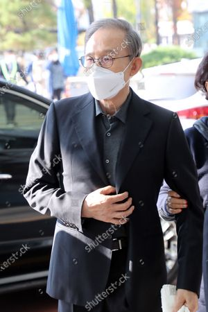 Former President Lee Myung-bak, helped by his wife, Kim Yoon-ok, arrives at Seoul National University Hospital in Seoul, South Korea, 30 October 2020, to see a doctor. The Supreme Court in Seoul upheld a lower court ruling of a 17-year prison term for Lee, who is out on bail, for embezzlement and bribery the previous day. He is scheduled to be imprisoned again on 02 November.