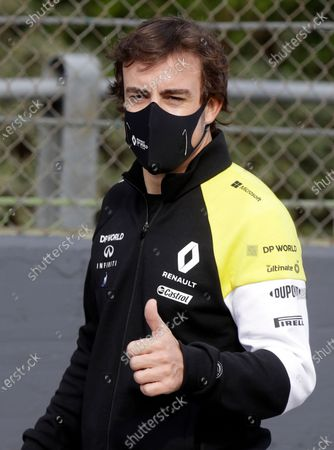 Former Formula One driver Spain's Fernando Alonso gives the thumbs as he walks on the track ahead of Sunday's Emilia Romagna Formula One Grand Prix, at the Dino and Enzo Ferrari racetrack, in Imola, Italy