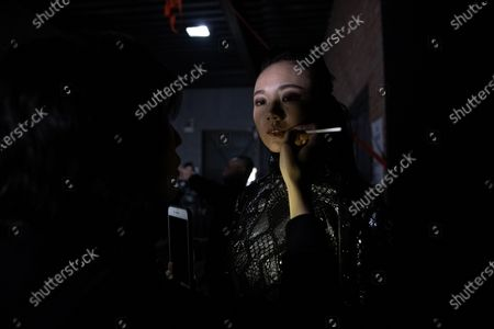A model gets her make-up backstage before the show CHEN.1988 by Long Chen during the China Fashion Week in Beijing, China, 30 October 2020. The fashion event runs from 24 October to 01 November 2020.