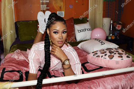 Pretty Vee attends Queen Naija's album release and listening party at The Gathering Spot