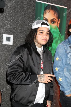 Young M.A attends Queen Naija's album release and listening party at The Gathering Spot