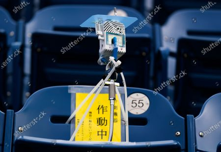 This photo shows a device to detect carbon dioxide installed in the seats of a baseball stadium, home for the Yokohama DeNA BayStars, in Yokohama, south of Tokyo on . The device was introduced during a media tour Friday